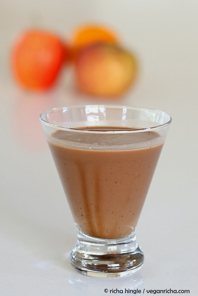 side view of a glass of vegan chocolate milkshake made with almond milk