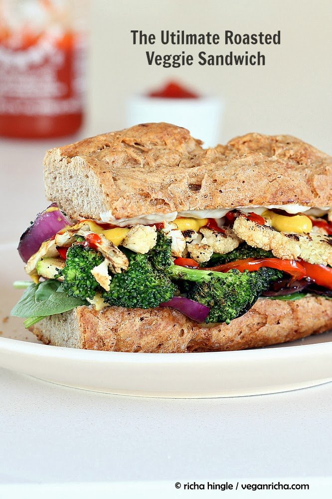 side view of a healthy vegan roasted vegetable sandwich with sriracha mayo and mustard