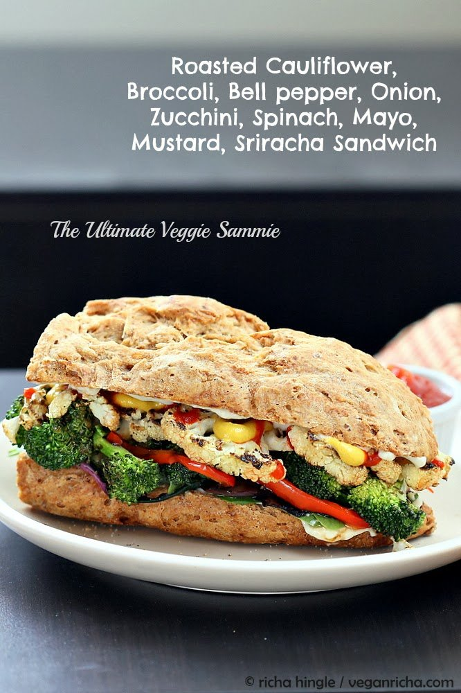 side view of a vegan roasted vegetable sandwich made with grilled broccoli, cauliflower, bell pepper and sriracha mayo