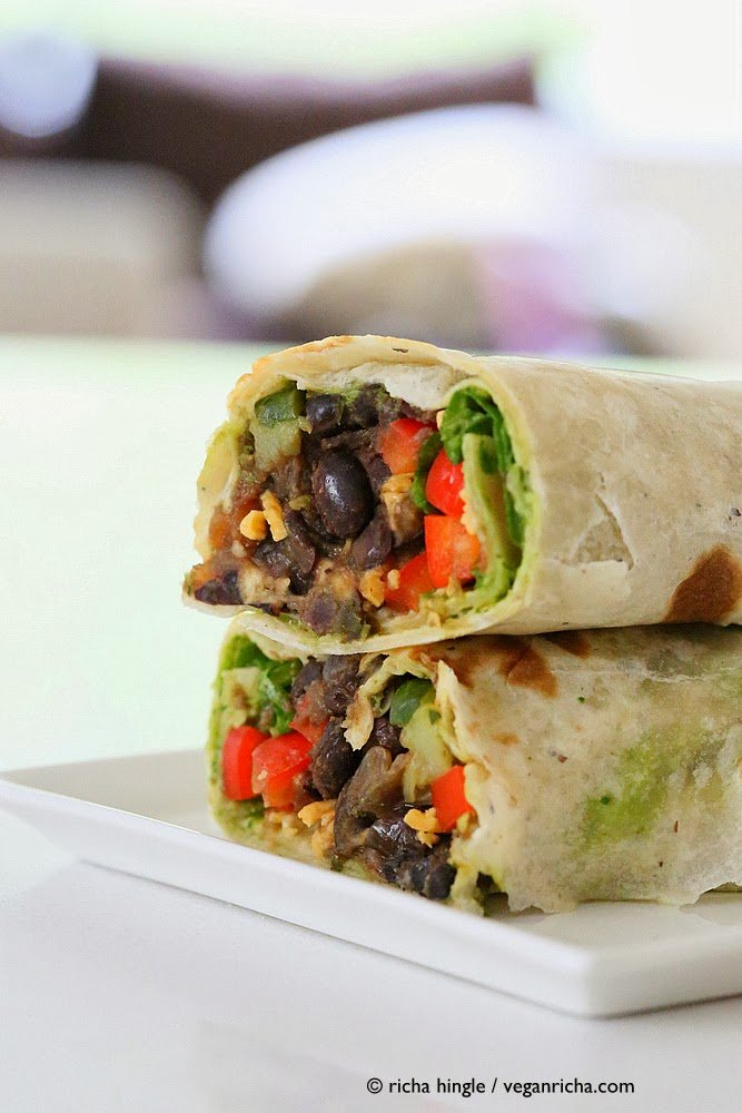 side view of two stacked haves of Vegan Smoky Black Bean Wraps with Parsley Chimichurri