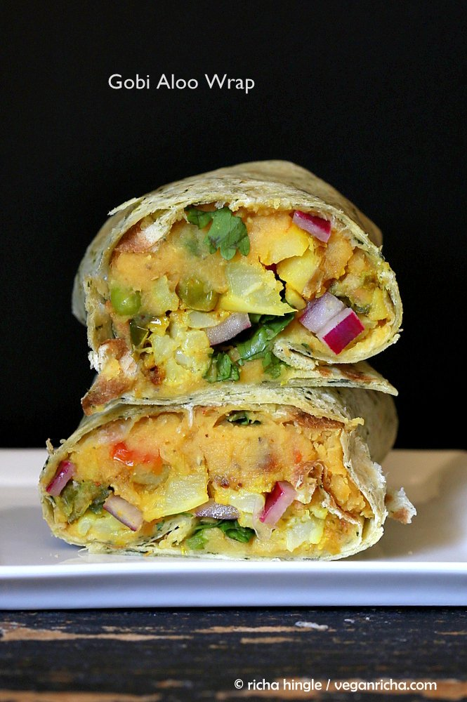 stacked vegan red lentil hummus wraps with pickled onions, potatoes and cauliflower