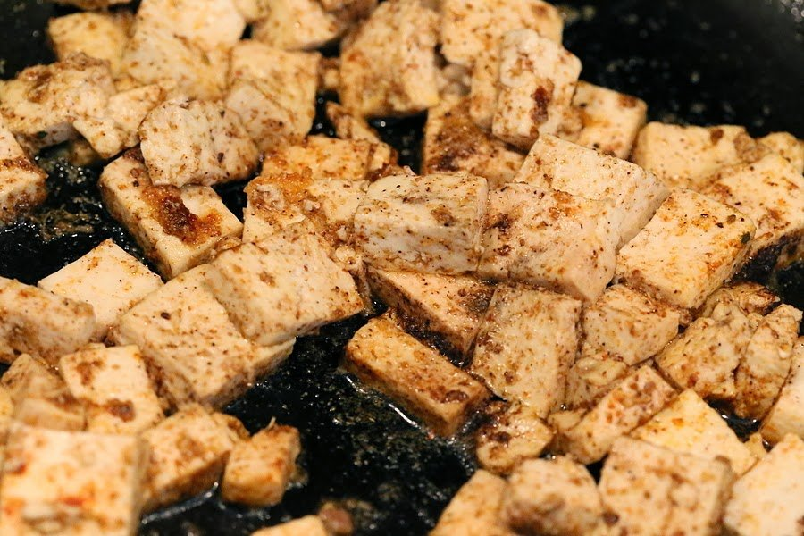 Tofu with spices in a skillet for our Vegan Palak tofu Paneer