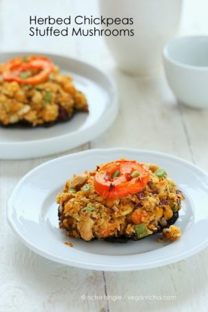 side view of vegan stuffed Portobello Mushrooms on a white plate