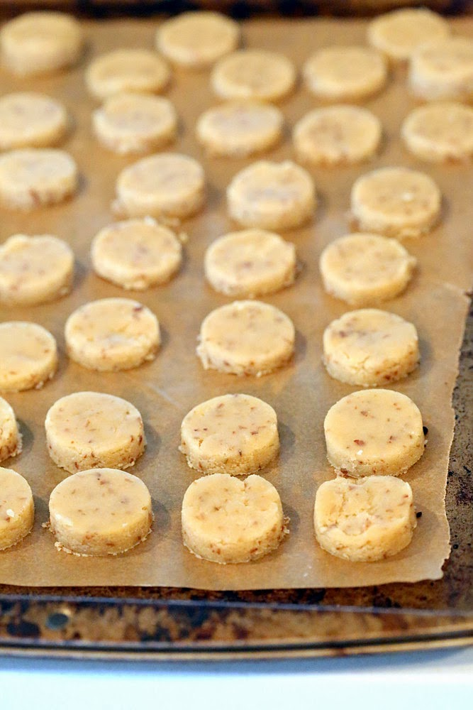 gluten-free vegan sugar cookies lined up on a baking sheet ready to be baked
