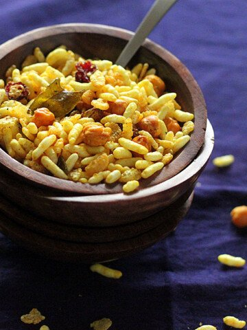 Chivda served in a small bowl on a dark work surface