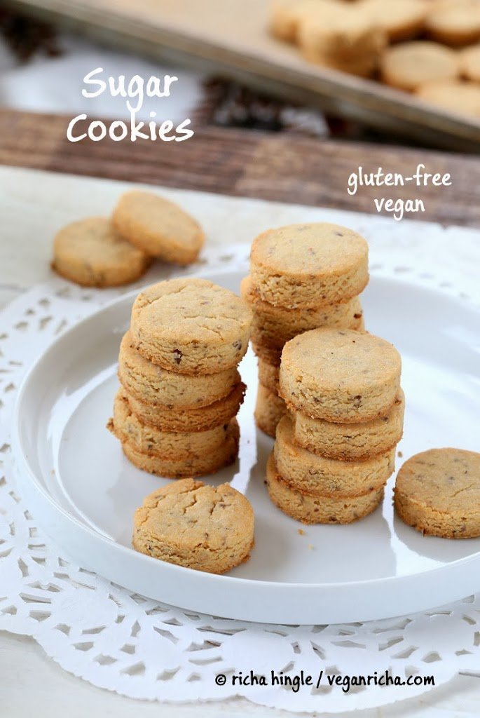 gluten-free vegan sugar cookies made with coconut flour stacked on a white cookie platter