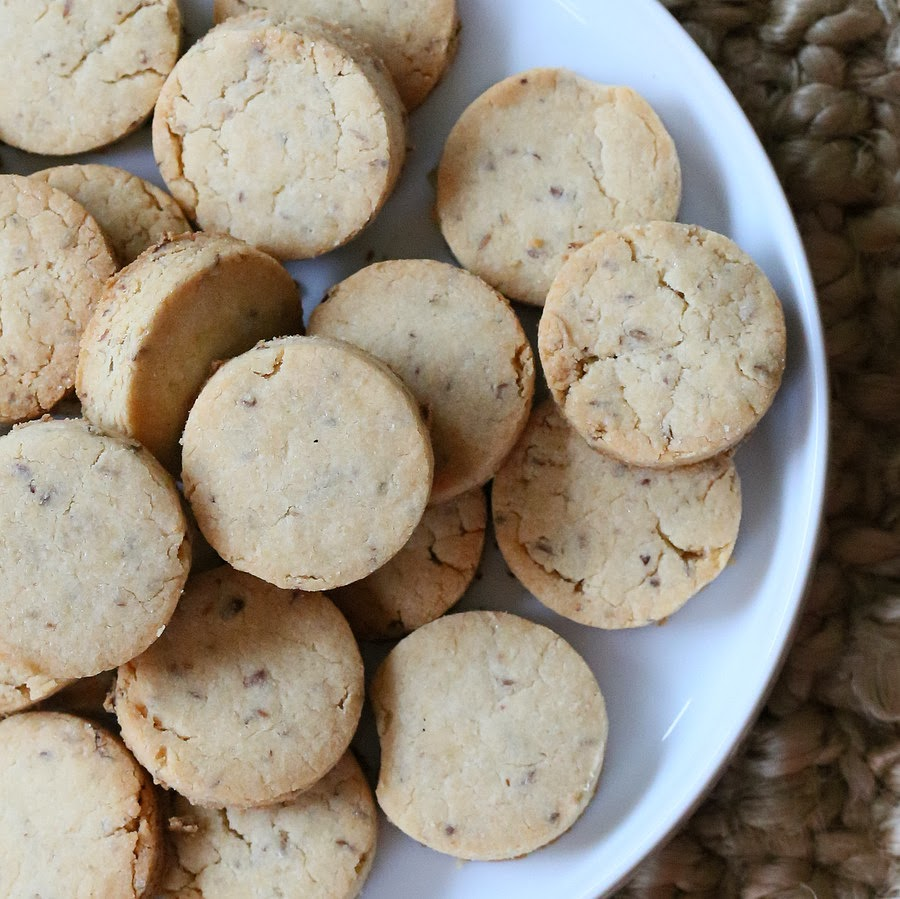 overhead shot of gluten-free vegan sugar cookies on a white cookie platter