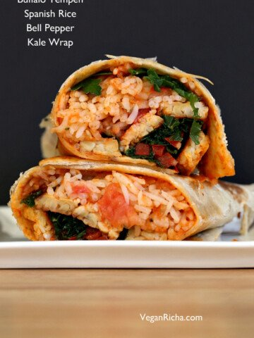 These Vegan Buffalo Tempeh Wrap s are paired with spanish rice, peppers and kale for a fantastic meal. Use gluten-free wraps to make them gluten free.