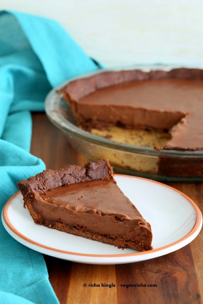 Vegan Chocolate Silk Pie is filled with smooth Dark chocolate filling, & a Almond Chocolate Crust. topped with cashew cream. Gluten-free Soy-free   VeganRicha.com