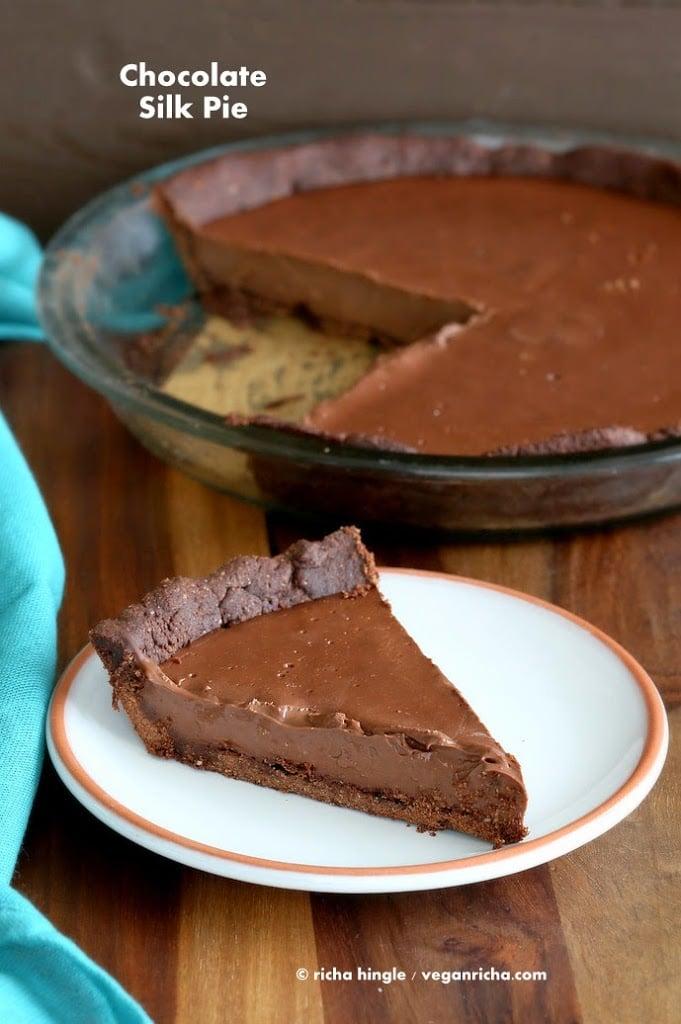 Vegan Chocolate Silk Pie is filled with smooth Dark chocolate filling, & Almond Chocolate Crust. topped with cashew cream. Gluten-free Soy-free Vegan VeganRicha.com