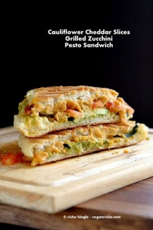 Cauliflower Cheddar, pesto, Grilled zucchini Sandwich on a wood board #VeganRicha