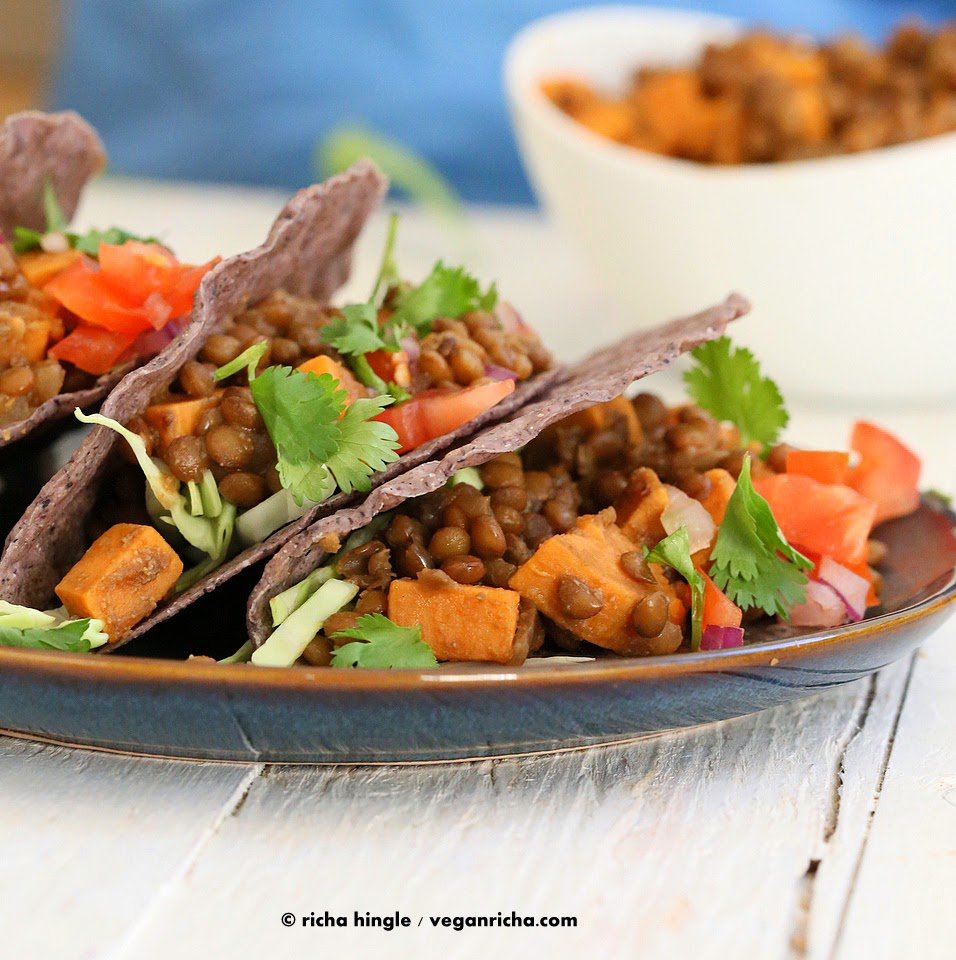 Smoky lentil and sweet potato tacos on a blue plate