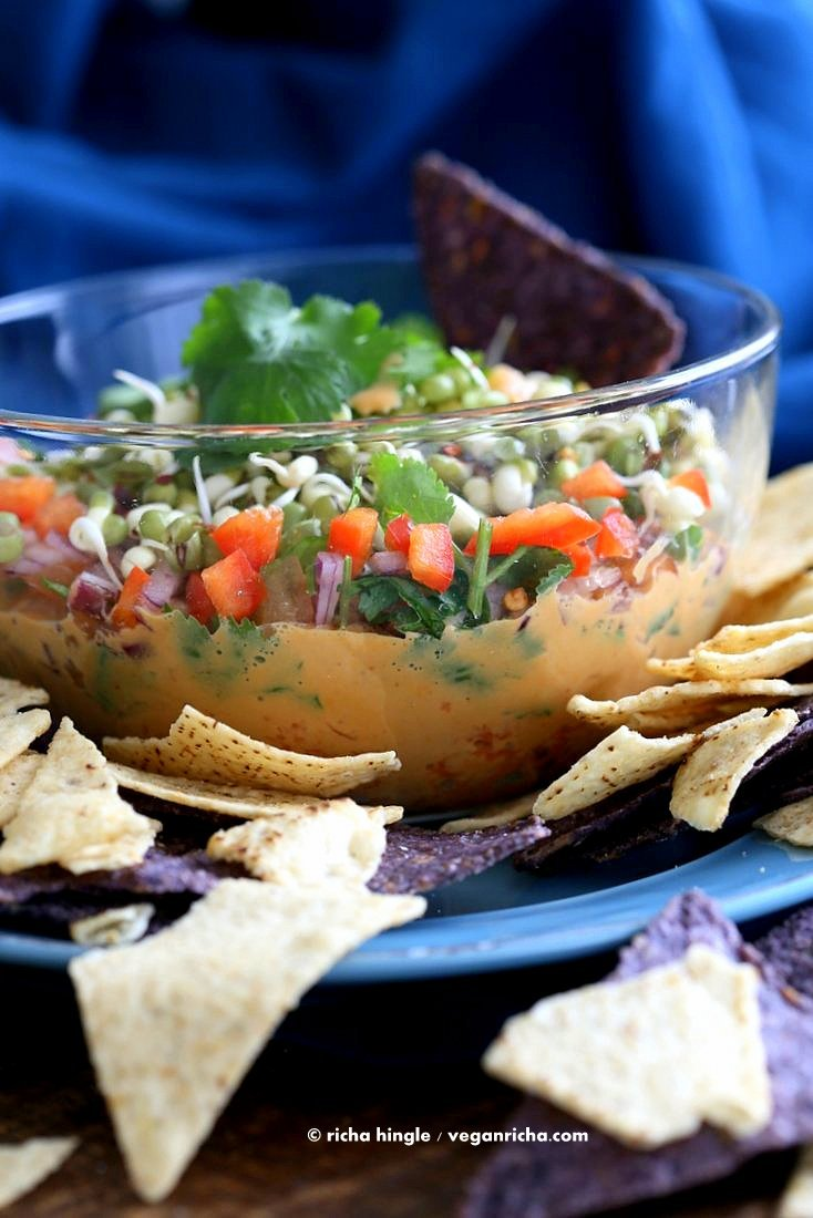 This Thai layered Dip has carrots, Peanut butter sauce, spicy salsa, cilantro, sprouts, & peanuts. all layered up for the perfect appetizer. #Vegan #Glutenfree #Recipe #VeganRicha | Vegan Richa