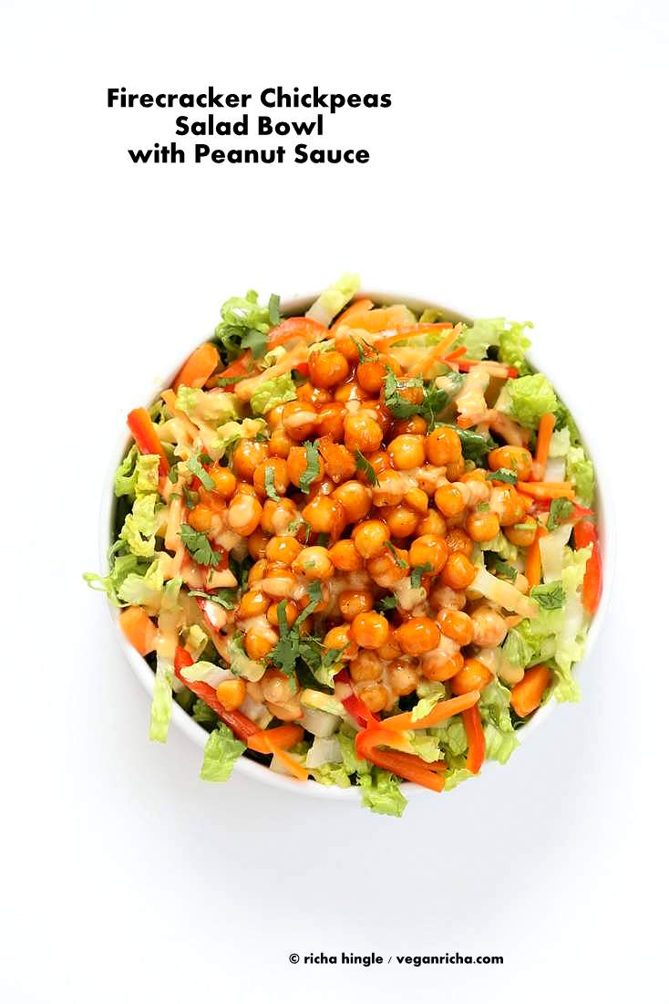 Chickpeas tossed in sweet spicy firecracker sauce and cooked to thicken the sauce. Firecracker Chickpeas Served with a crunchy lettuce, carrot, red bell pepper salad, a light drizzle of peanut sauce and garnished with cilantro/scallions #vegan #veganricha #glutenfree | Vegan Richa
