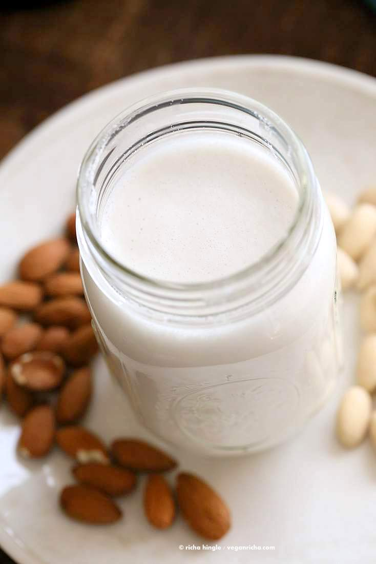 How to make Almond Milk with raw almonds or blanched almonds. Blanched almond milk has a less prominent flavor which works great for Indian Chai | Vegan Richa