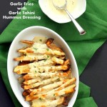 Baked Fries with Garlic Sauce - Russet potato baked and drenched in tahini hummus lemon sauce | VeganRicha.com #vegan #appetizer #glutenfree #soyfree #recipe