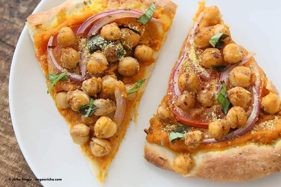 Chickpea Pumpkin Veggie Pizza with Basic Pizza crust. Pumpkin sauce spiced with herbs and spices, topped with spicy chickpeas, veggies and pepita parmesan | VeganRicha.com #vegan #pumpkin #chickpea #pizza #fall