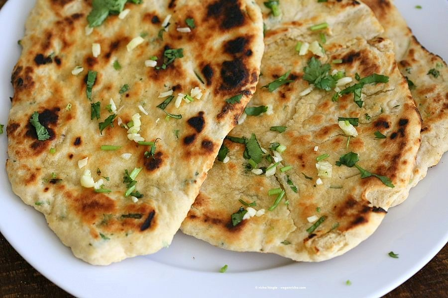 Garlic flatbread recipe No Yeast. This easy garlic herb flatbread has no yeast, doesn't need hours to rest, and has a secret ingredient. | VeganRicha.com #vegan #flatbread #recipe