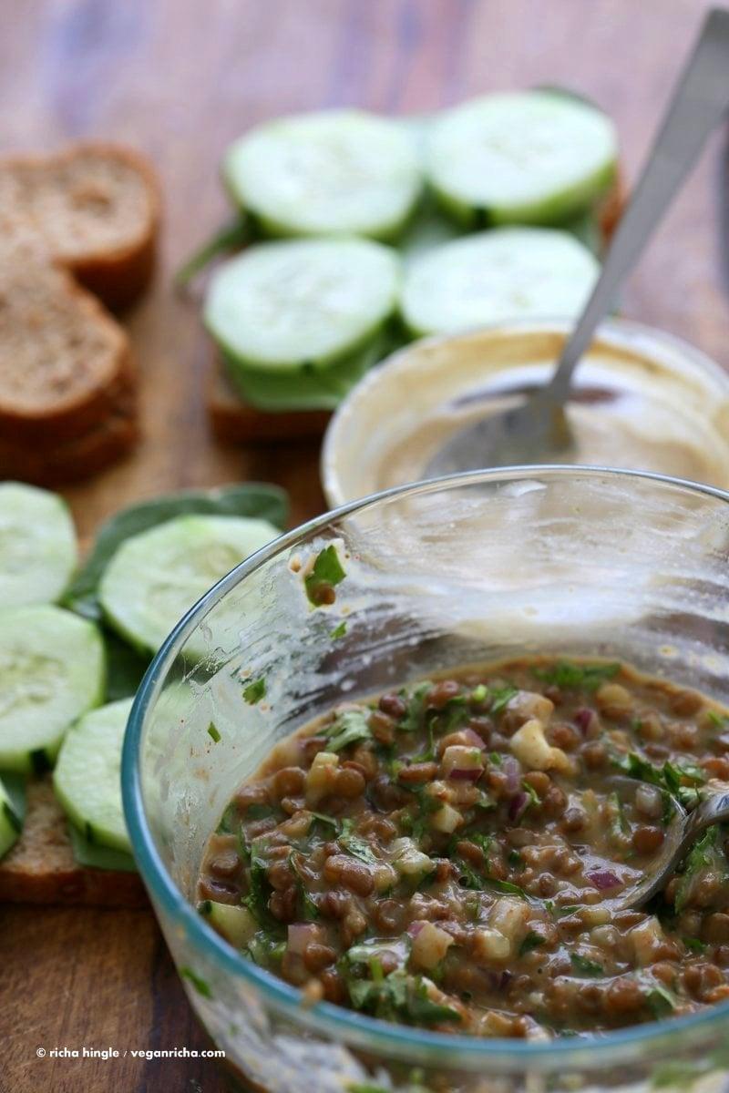 Falafel Spice Lentil Salad Sandwich with lemony tahini dressing. Lentils spiced with falafel spices & pickle, serve in sandwich or pita bread.   VeganRicha.com #lentils #sandwich #vegan #recipe