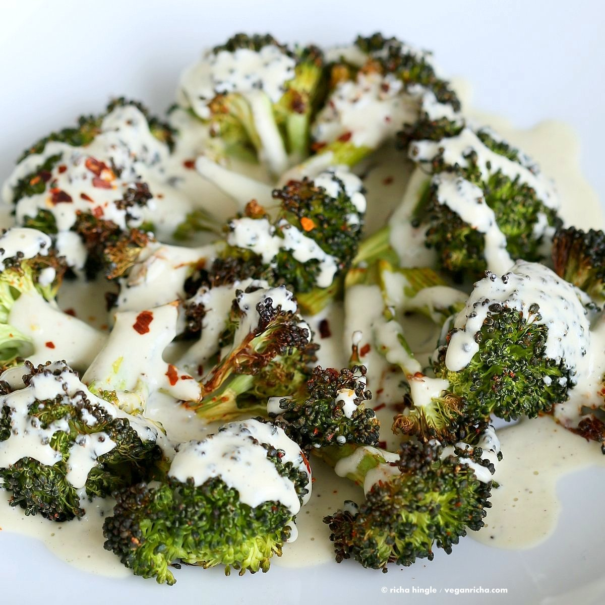 Roasted Broccoli with Creamy Basil Dressing. Broccoli tossed in garlic, cayenne, and baked. Served with cheesy cashew basil sauce. Vegan Glutenfree soyfree Recipe | VeganRicha.com