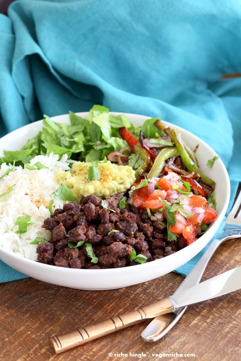 Easy Burrito Bowl. Spicy black beans, roasted peppers and veggies, zesty guacamole, pico de gallo, fresh lettuce. DIY Burrito Bowl Chipotle style. | VeganRicha.com #vegan #glutenfree #soyfree #bowl #recipe