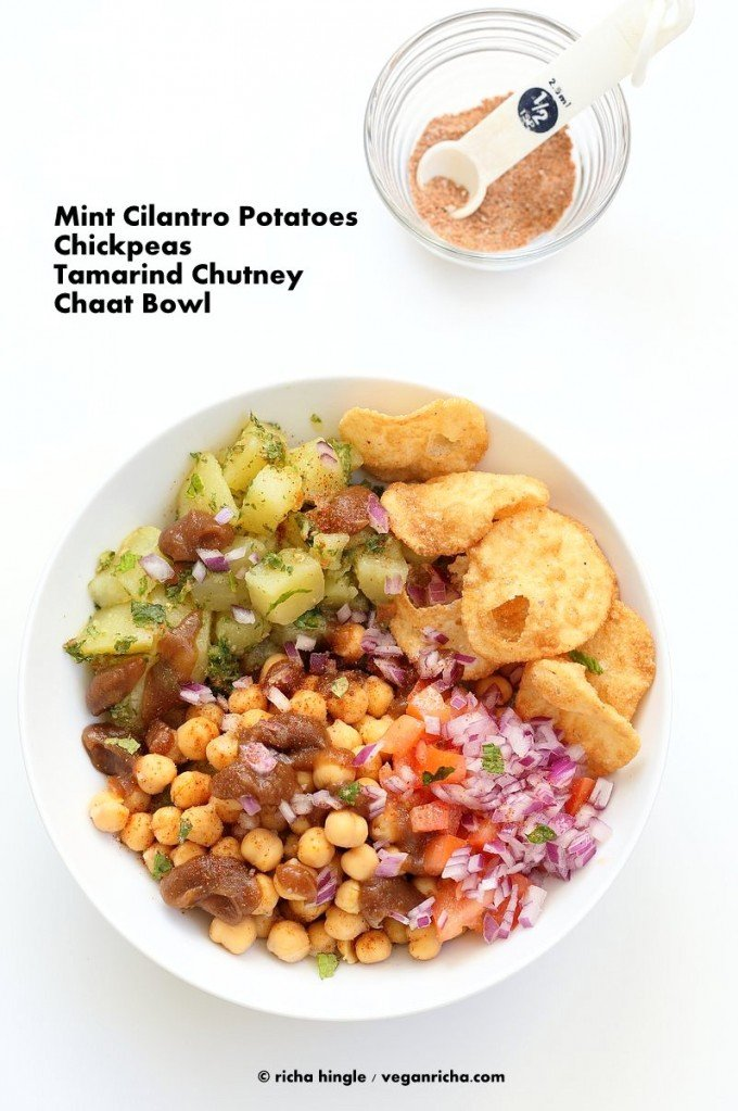 Chickpea Aloo Chaat Bowl. Mint cilantro Potatoes, spiced chickpeas, tamarind date chutney bowl with onions, tomatoes and chaat masala. | VeganRicha.com #vegan #glutenfree #bowl #recipe