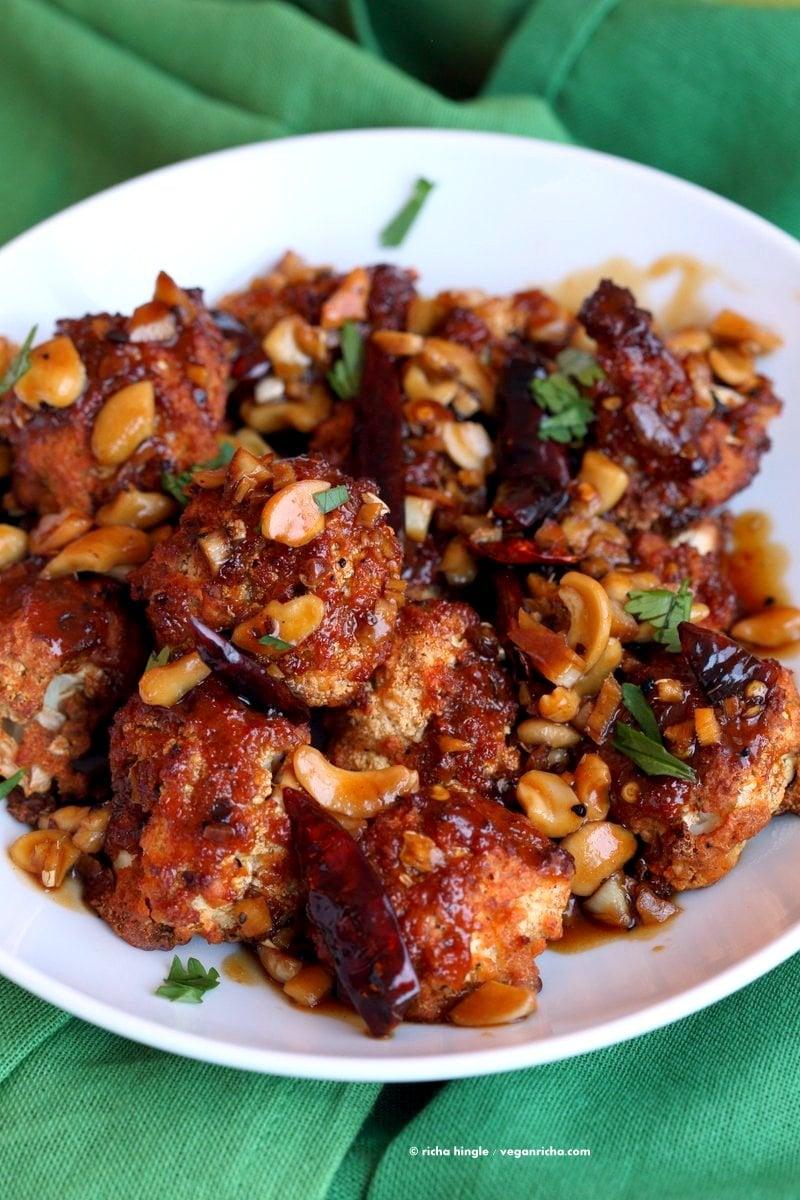 Crispy Kung Pao Cauliflower. Cauliflower battered and baked and tossed in spicy kung pao sauce. | VeganRicha.com #vegan #appetizer #snack #cauliflower #kungpao #recipe