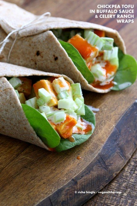 Buffalo Tofu wrap with Chickpea Tofu. Soy-free Chickpea flour Tofu tossed in buffalo hot sauce, layered with celery, spinach, cucumbers and vegan ranch. Easy weekday meal Recipe | VeganRicha.com #glutenfree #veganricha #vegan