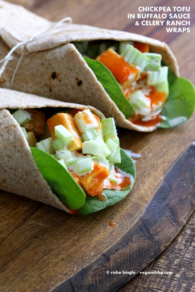 Buffalo Tofu wrap with Chickpea Tofu. Soy-free Chickpea flour Tofu tossed in buffalo hot sauce, layered with celery, spinach, cucumbers and vegan ranch. Easy weekday meal Recipe | VeganRicha.com
