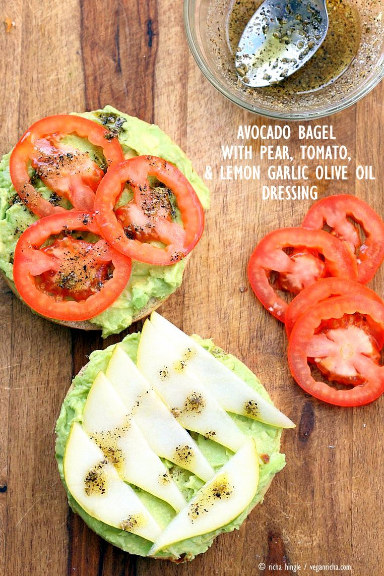 Avocado Bagels with Pears and Tomatoes and Mediterranean Oregano Garlic Olive Oil Dressing Bagel Avocado Toast. Easy Vegan Snack or Breakfast. | VeganRicha.com