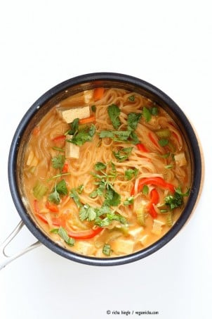 One pot peanut sauce noodles, Ready in 20 minutes! Brown Rice Noodles, Veggies, Peanut or Almond Butter, spices, flavors, boil and done. Easy Quick Weeknight Dinner Recipe | VeganRicha.com