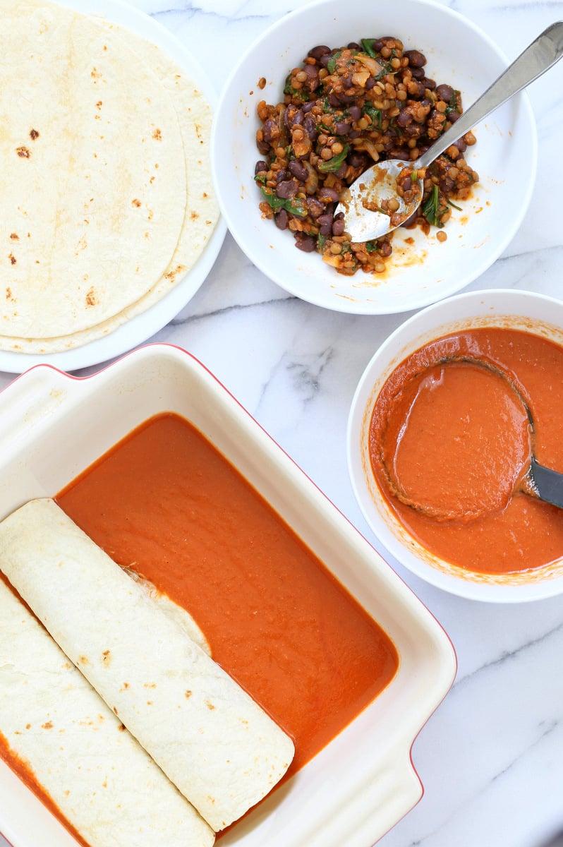 Vegan Enchiladas Recipe. Easy Enchilada Recipe with Blender Enchilada Sauce, soft tortillas filled with Black beans and Lentils. Vegan Soy-free Recipe. Can be Gluten-free. Ready within 1 Hour. | VeganRicha.com