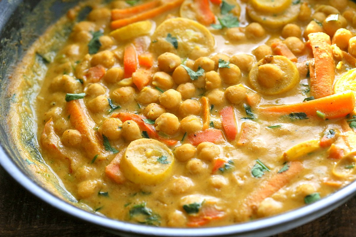 Chickpeas in Turmeric Peanut Butter Curry. Easy Nut Butter Curry Sauce with Summer veggies and Chickpeas. Vegan Gluten-free Soyfree Recipe   VeganRicha.com