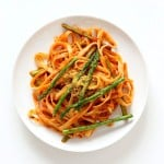 Fettuccine with Tomato Cream Sauce and Asparagus. Easy tomato Cream sauce with pasta and garlic roasted Asparagus. Use other veggies of choice. Add some chickpea chorizo or smoked coconut for variation. Vegan Soyfree Recipe. Can be gluten-free with gf pasta. | VeganRicha.com #vegan #glutenfree #veganricha