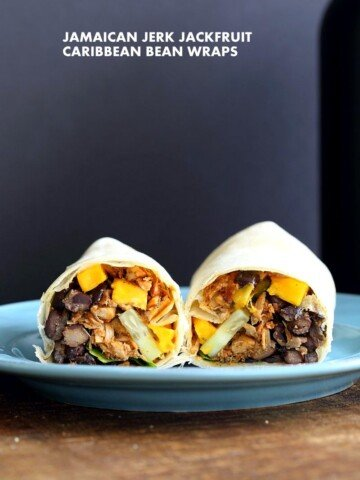 Jamaican Jerk Jackfruit Caribbean Black Bean Mango Wraps. These Burritos are packed with hot shredded jerk jackfruit, black beans, mango and cucumbers. Serve as wraps or make a sandwich or bowl. Vegan Soy-free Recipe. Can be gluten-free | VeganRicha.com #vegan #glutenfree #veganricha