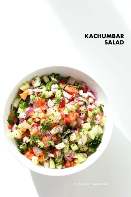 Kachumber Salad - Cucumber Tomato Onion Salad Recipe. Kachumbar is a simple chopped Summer Salad with chopped onions, tomatoes, cucumbers and a salt pepper lemon dressing. Serve as a side with Indian curries, or as a dip with chips, or over burgers. Vegan Gluten-free Soy-free Oil-free Recipe | VeganRicha.com #vegan #glutenfree #veganricha