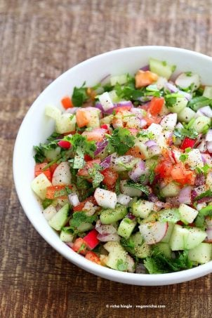 Kachumber Salad - Cucumber Tomato Onion Salad Recipe. Kachumbar is a simple chopped Summer Salad with chopped onions, tomatoes, cucumbers and a salt pepper lemon dressing. Serve as a side with Indian curries, or as a dip with chips, or over burgers. Vegan Gluten-free Soy-free Oil-free Recipe | VeganRicha.com
