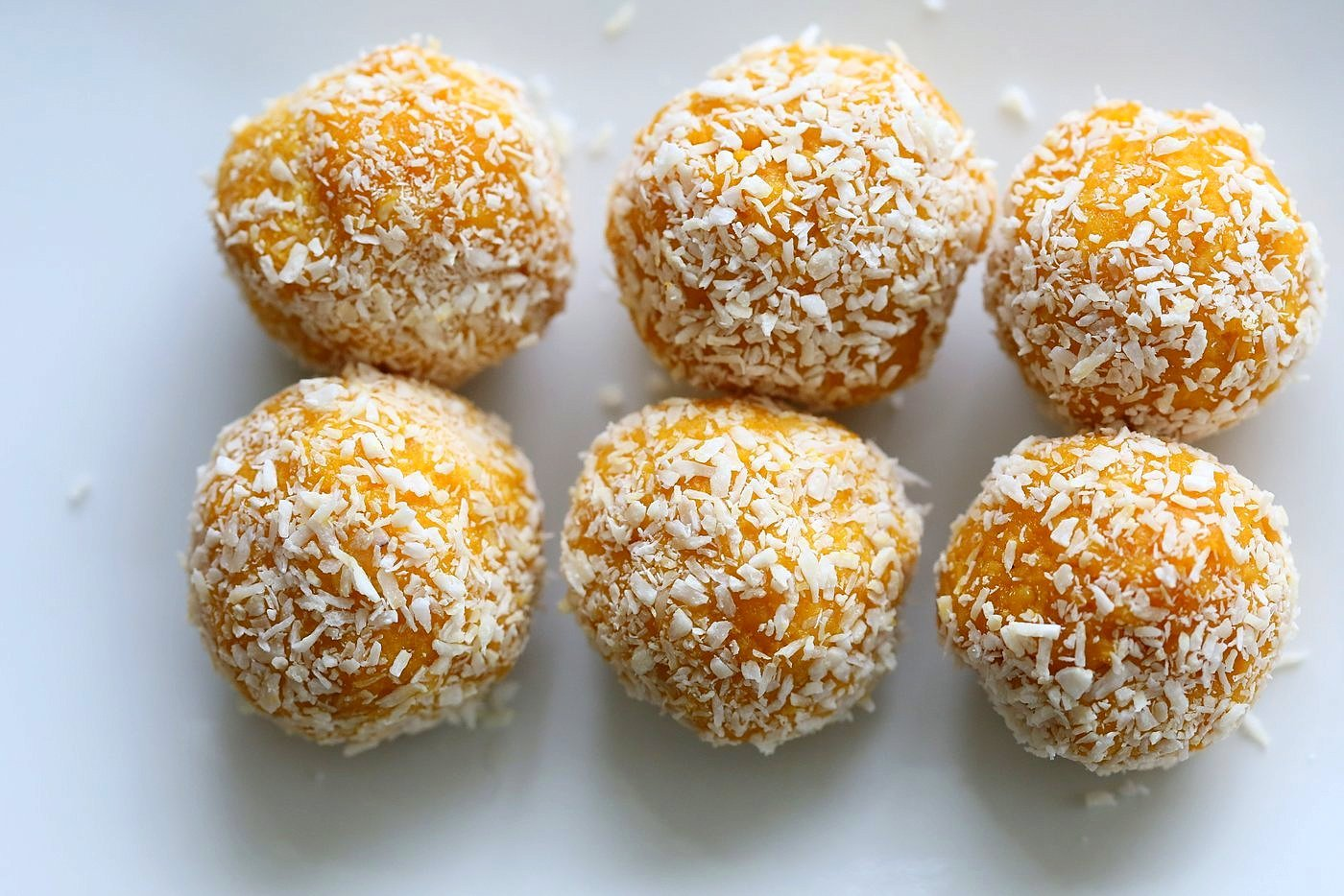 Mango Coconut Ladoo. Fudgy balls made with Mango Puree, Coconut and almond meal. Vegan gluten-free recipe. | VeganRicha.com