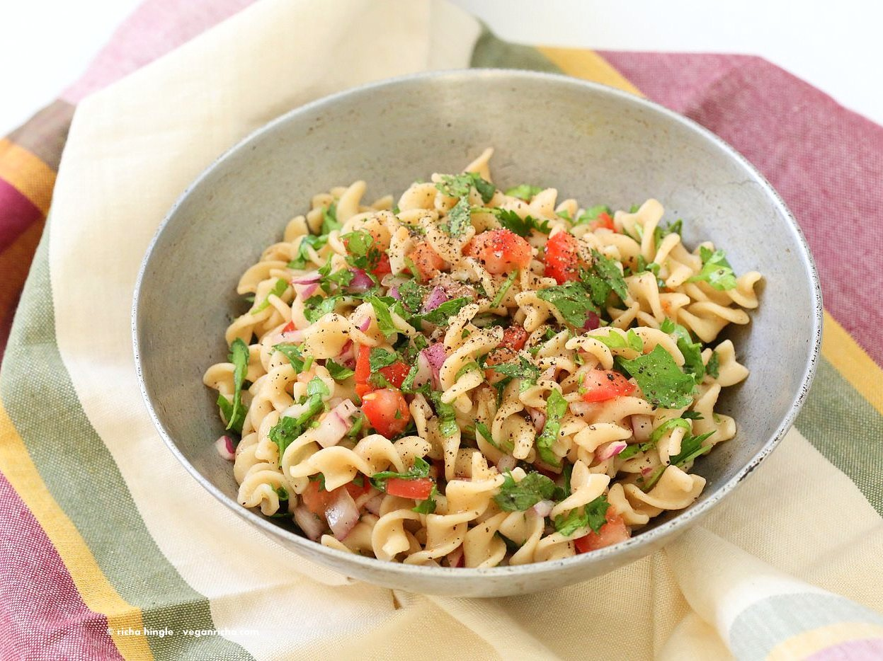 Tabbouleh Pasta Salad. Parsley, tomatoes, fusilli pasta dressed with olive oil, salt, pepper and lemon. Fresh Summer Salad. Vegan Soy-free Recipe. Can be made gluten-free with gf pasta. | VeganRicha.com