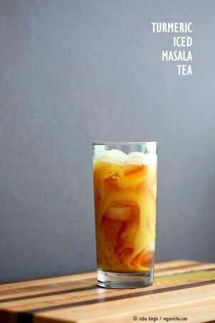 Cardamom Cinnamon Turmeric Iced Tea. Spiced Iced tea like Thai Iced tea with turmeric coconut milk and Indian masala chai spices and ginger. Golden Milk Iced Tea. Vegan Gluten-free Soy-free Recipe | VeganRicha.com #vegan #glutenfree #veganricha