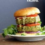 Easy Vegan Falafel Burger. Chickpea patties with tahini dressing and hummus make for a filling and flavorful burger. Vegan Soy-free Recipe. Can be made gluten-free   VeganRicha.com