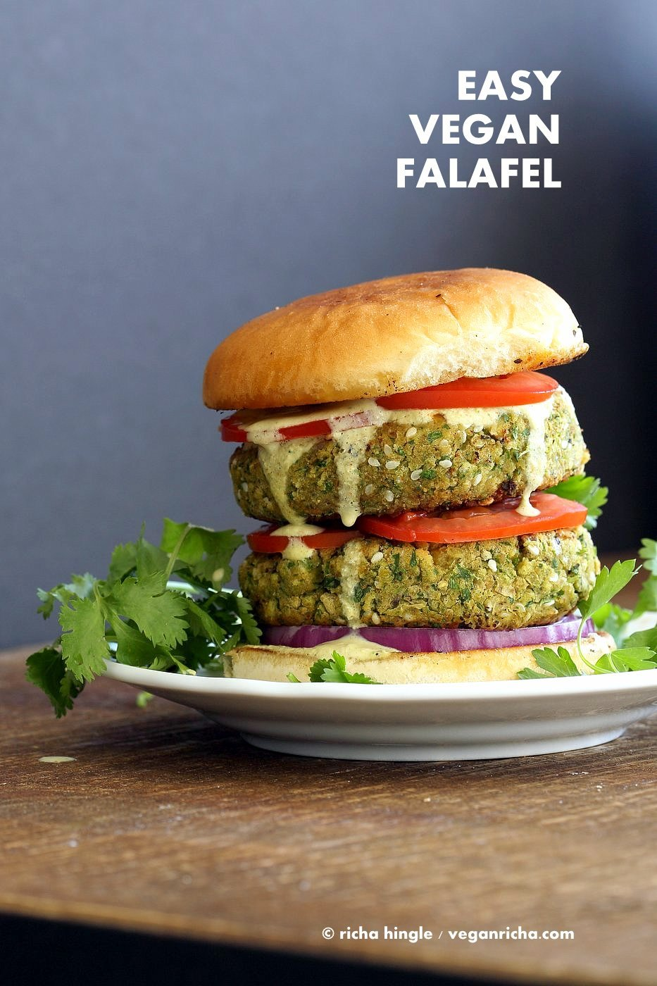 Easy Vegan Falafel Burger. Chickpea patties with tahini dressing and hummus make for a filling and flavorful burger. Vegan Soy-free Recipe. Can be made gluten-free | VeganRicha.com