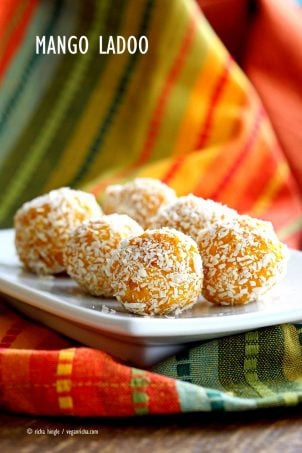 Mango Coconut Ladoo. Fudgy Mango balls made with Mango Puree, Coconut and almond meal. Vegan gluten-free recipe. Easy soy-free dessert or snack. | VeganRicha.com #glutenfree #veganricha #vegan