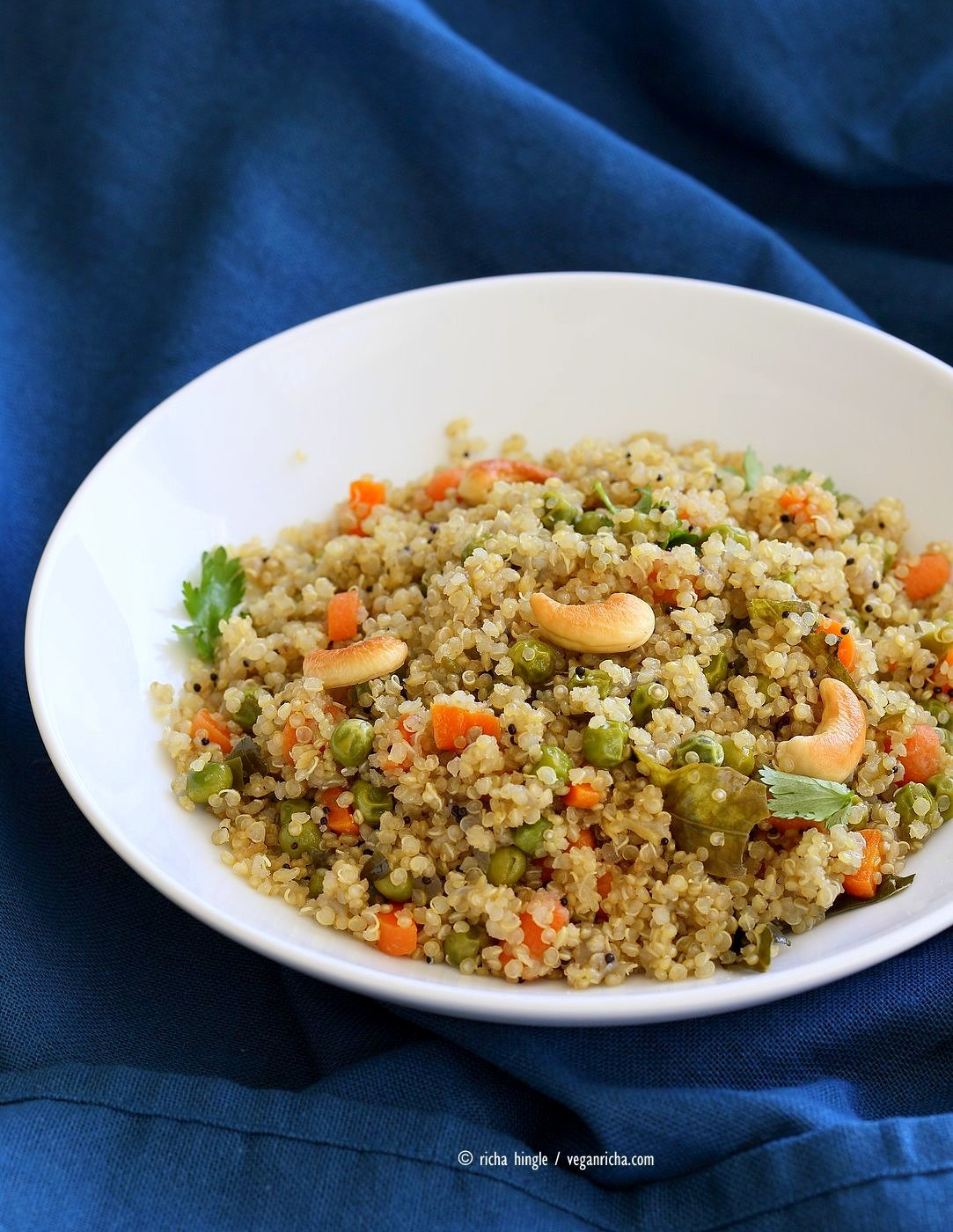 Quinoa Upma Recipe. Indian Savory Breakfast or Side with Quinoa with mustard seeds, toasted cashews, carrots and peas. Vegan Gluten-free Soy-free Recipe | VeganRicha.com