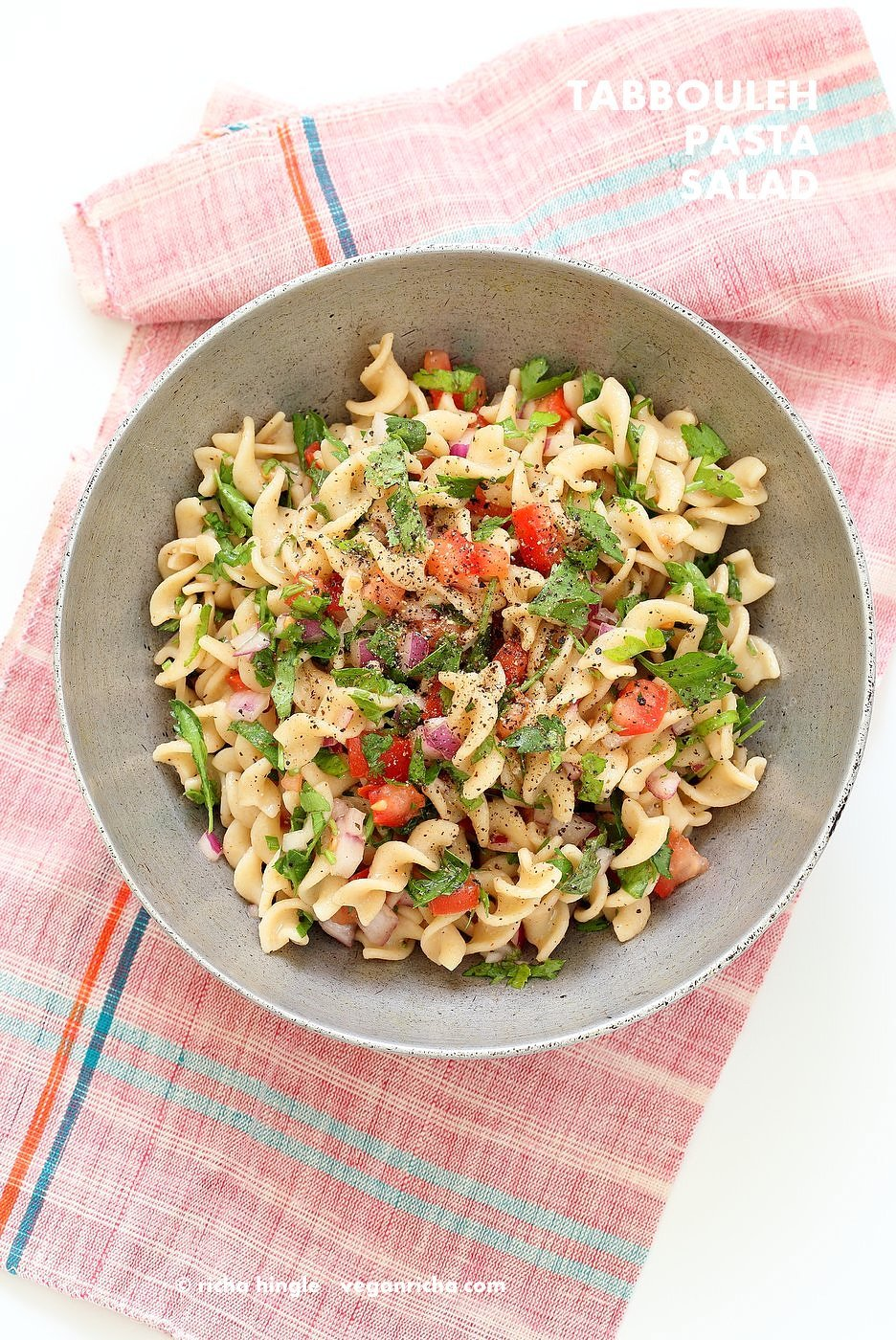 Tabbouleh Pasta Salad. Parsley, tomatoes, fusilli pasta dressed with olive oil, salt, pepper and lemon. Fresh Summer Salad. #Vegan #Soyfree Recipe. Can be made #glutenfree with gf pasta. | VeganRicha.com
