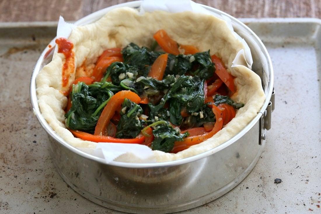 Vegan Deep Dish Pizza Recipe. Easy Deep Dish Pizza with from scratch crust, red pepper, spinach, vegan mozzarella and basil. Vegan Pizza Recipe.   familycuisine.net