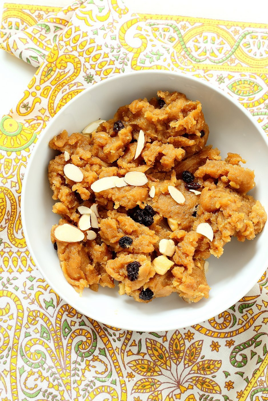 Besan Halwa is a fudgy dessert made with chickpea flour or besan. Chickpea flour Spoon fudge with cardamom and nuts. Use other grain or bean or lentil flours for variation. Vegan Gluten-free Grain-free Dessert Recipe. | VeganRicha.com