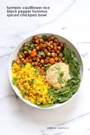 Turmeric Cauliflower Rice, Spiced Chickpeas or lentils, Black pepper hummus and Greens bowl. Amazing Flavors for any meal. Ready within 25 minutes. Vegan Gluten-free Soy-free Recipe | VeganRicha.com #glutenfree #veganricha #vegan