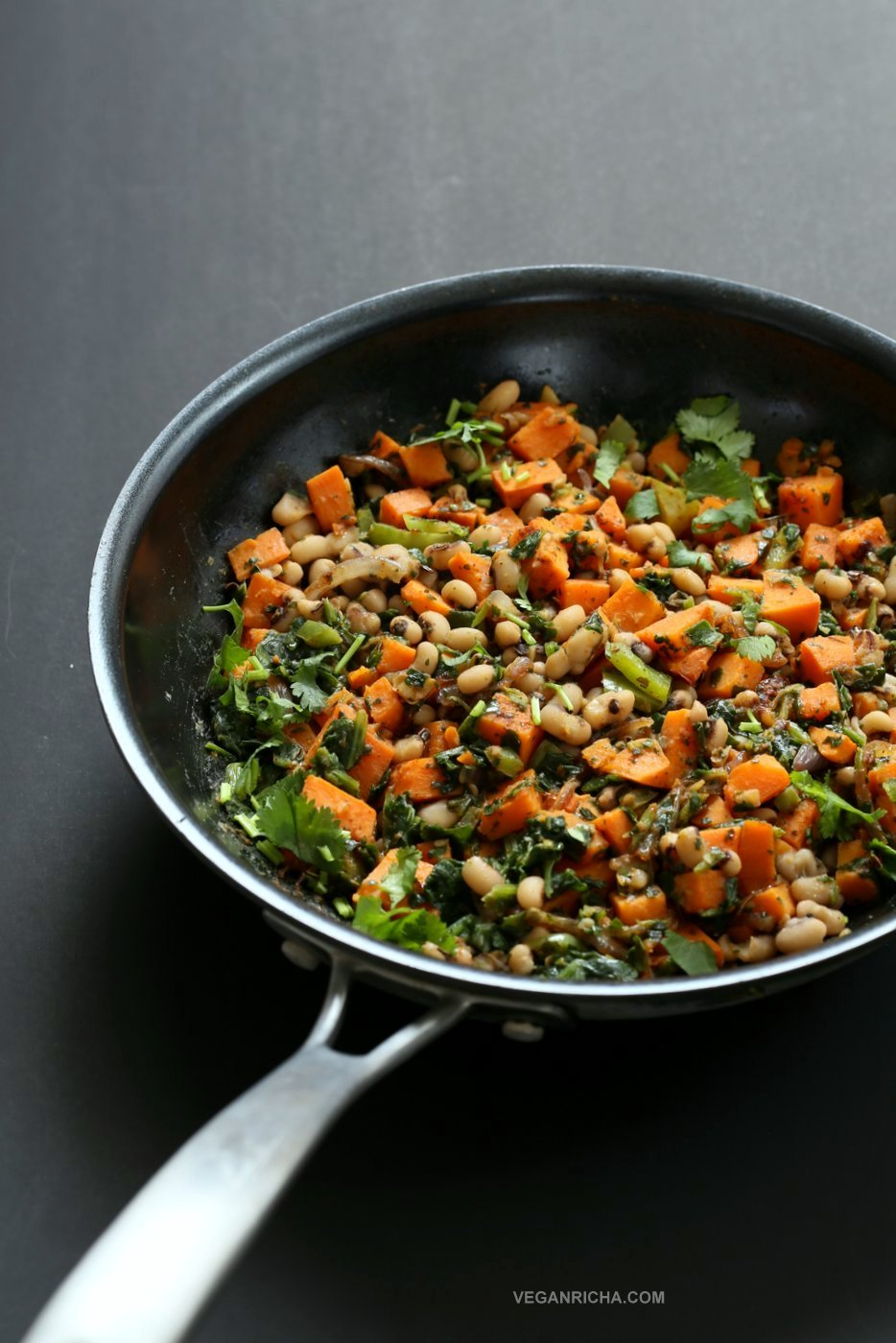 Bring in the new year with this plentiful Black eyed pea and Sweet Potato Hash with Harissa Spice. Ready in 20 minutes. Serve over toast with a creamy dressing or avocado. #Vegan #Glutenfree #Soyfree #Recipe #veganricha | VeganRicha.com