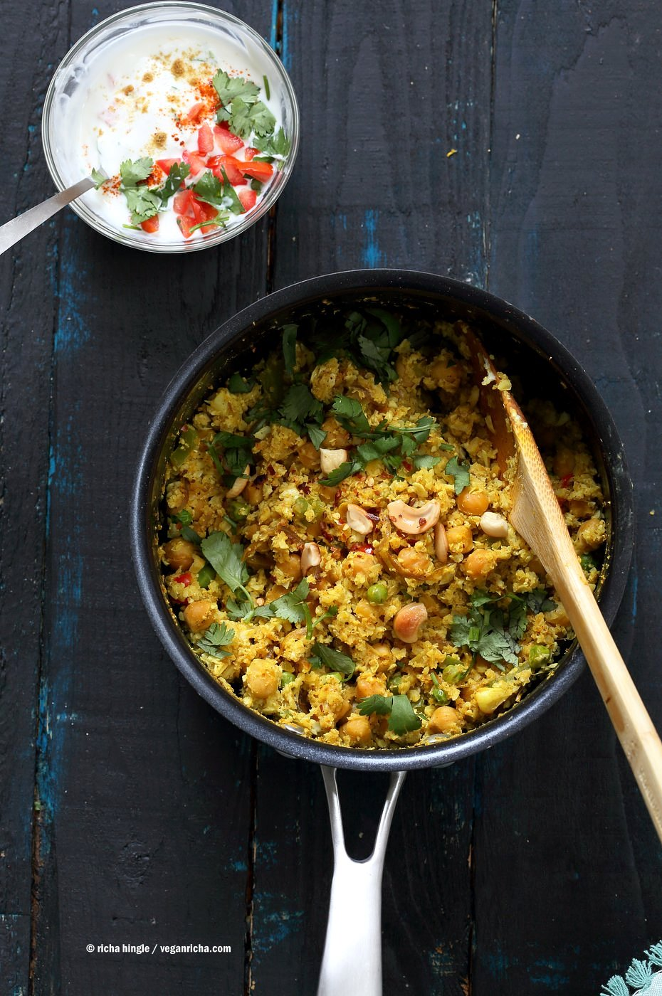 Chickpea Cauliflower Rice Biryani. 1 pot 30 Minute Meal with Veggies, Chickpeas, Spices, and Cauliflower Rice. Served with tomato raita. Vegan Gluten-free Soy-free Grain-free Recipe| VeganRicha.com